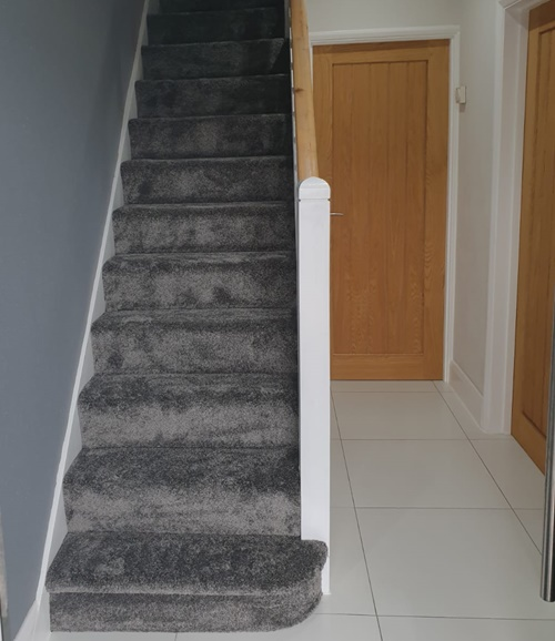 Deep pile carpet fitted on stairs